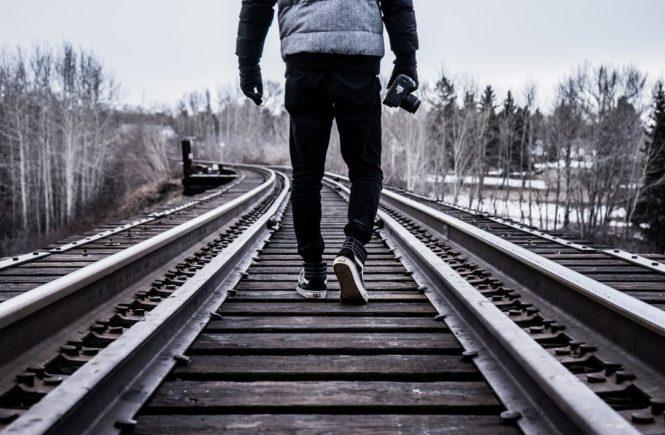 running along railroad tracks