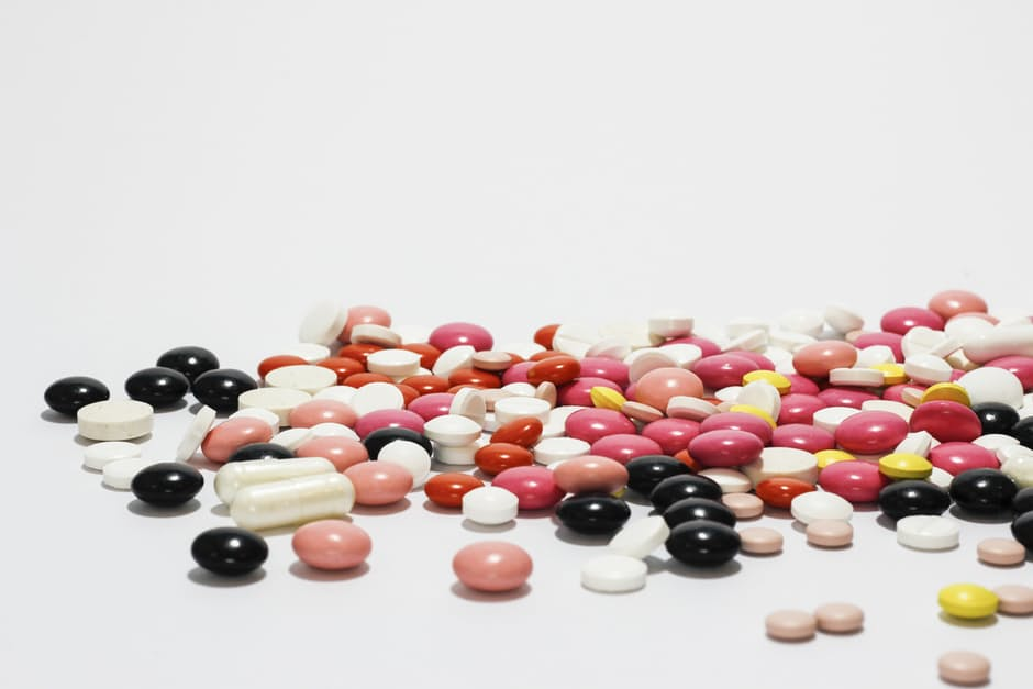 Supplements pill pile many colors