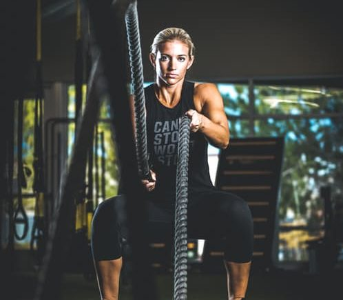 losing fat fast woman fitness ropes