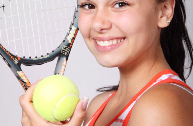 Fun Side Of Fitness tennis girl smiling