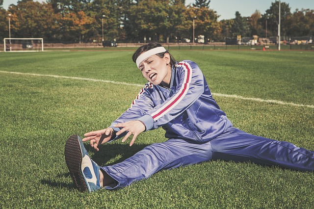Are You Healthy woman stretching in tracksuit