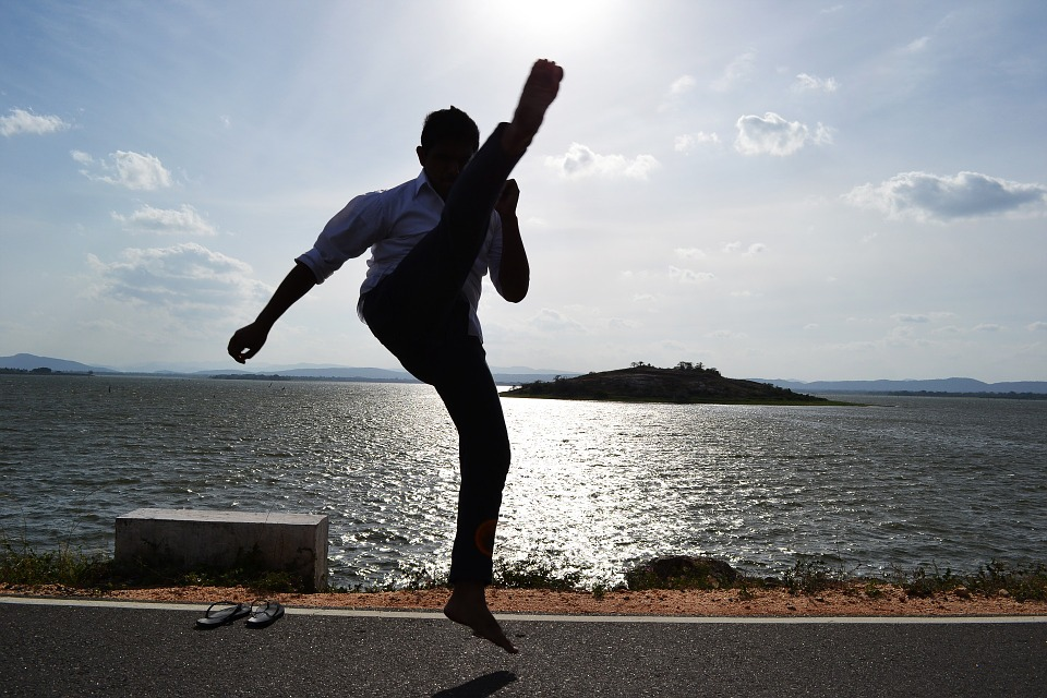 Fun Side Of Fitness outdoor man kicking