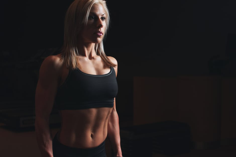 Good Home Gym woman in the dark