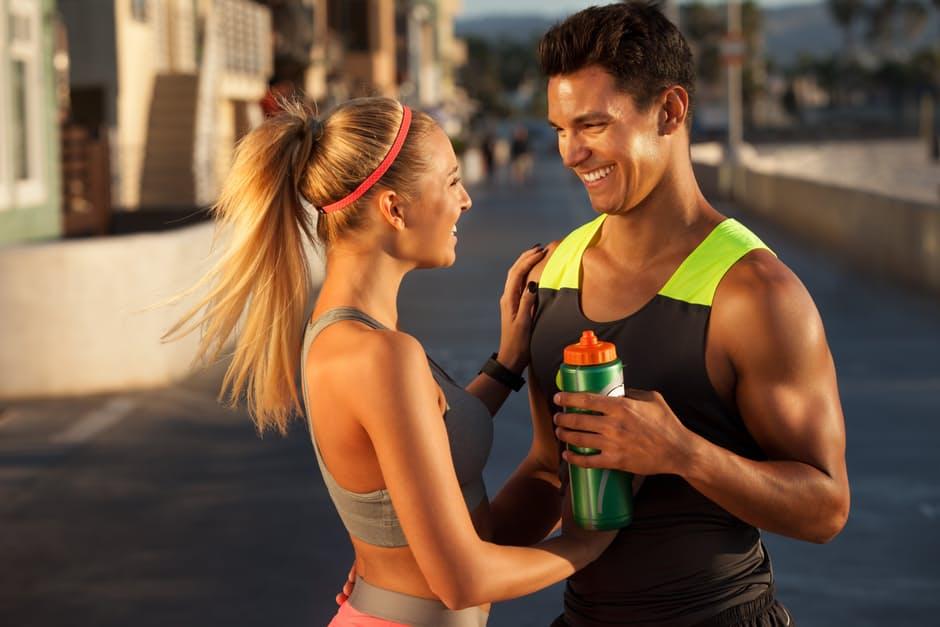 Fitness Partner couple refreshing smiling