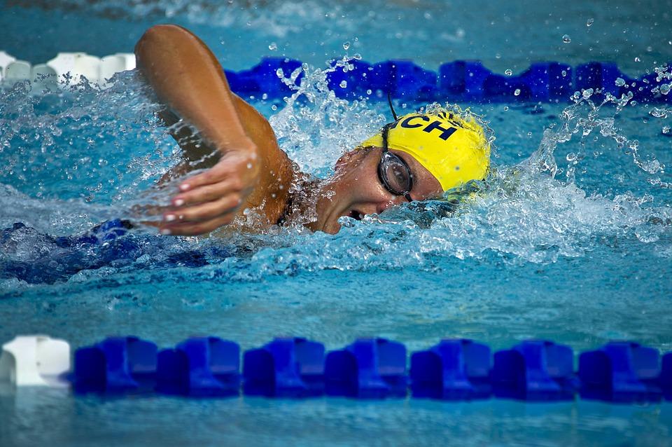 swim fitness man doing swim stroke