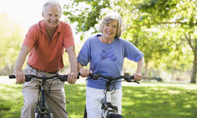 elderly people exercise bike workout