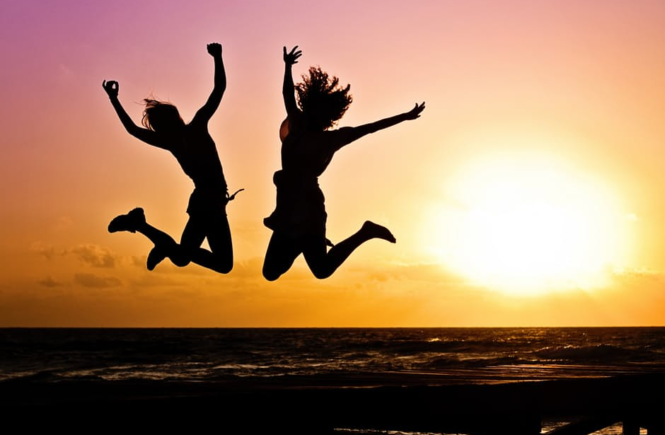 Strengthen core jumping at sunset