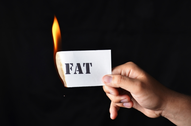 Burn Fat paper lit on fire hand holding