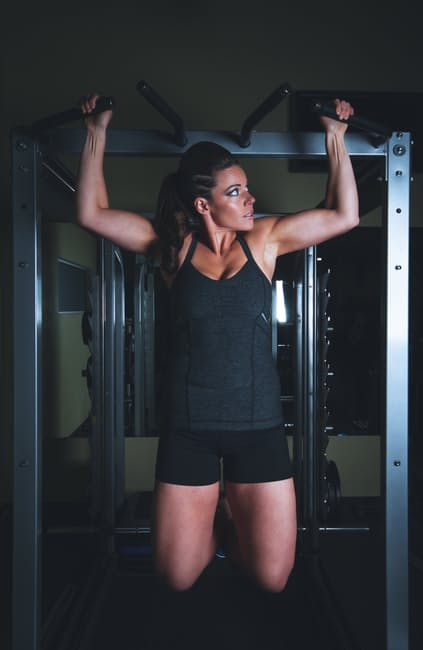 Working out at home woman motivation squat rack