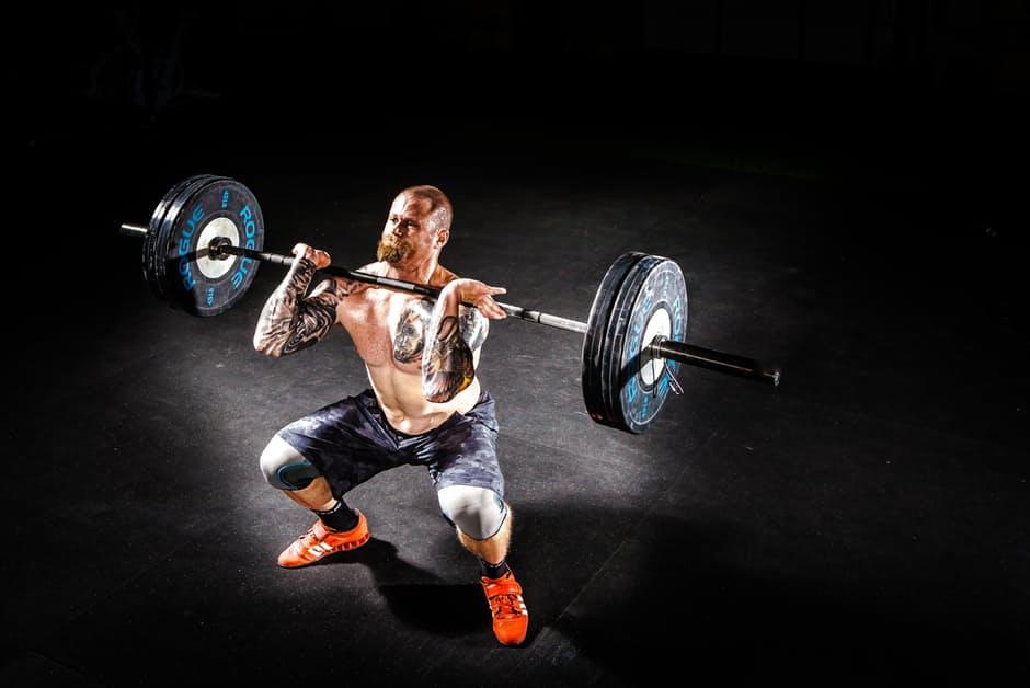 Workout Routine man squatting weights