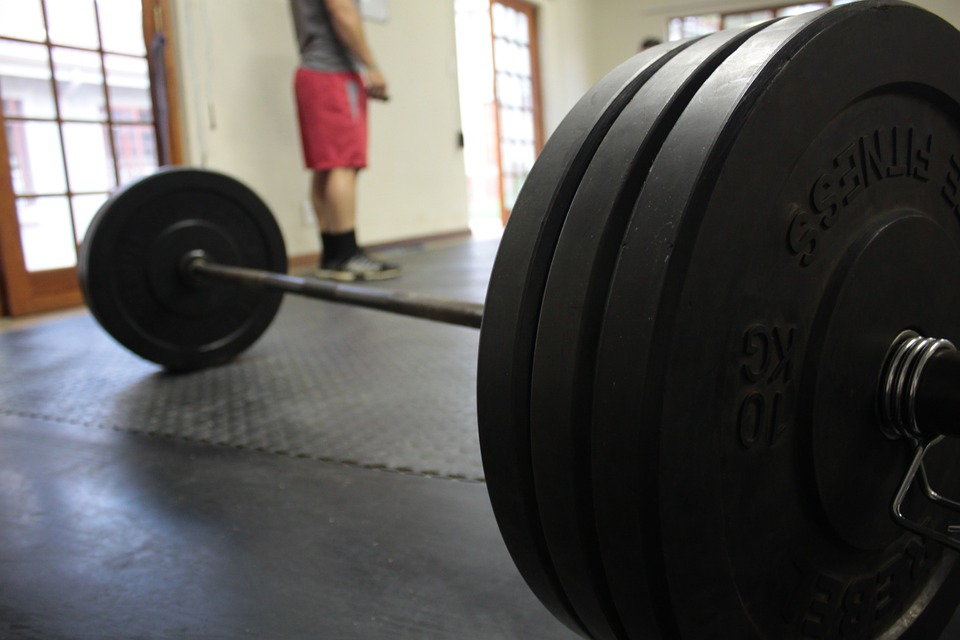 Opening a gym barbell on ground