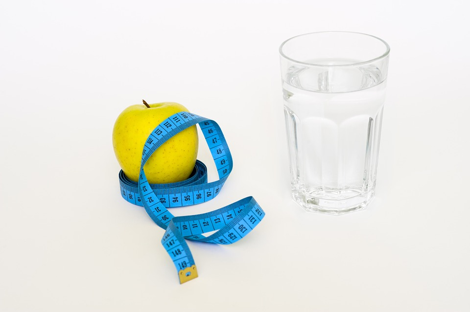 Weight Loss tape measure apple and water