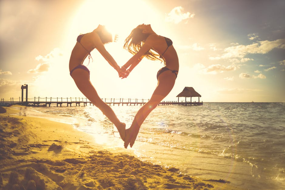 Angioplasty girls jumping in air forming heart