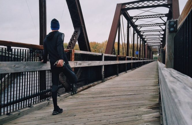common injuries in runners stretching outside
