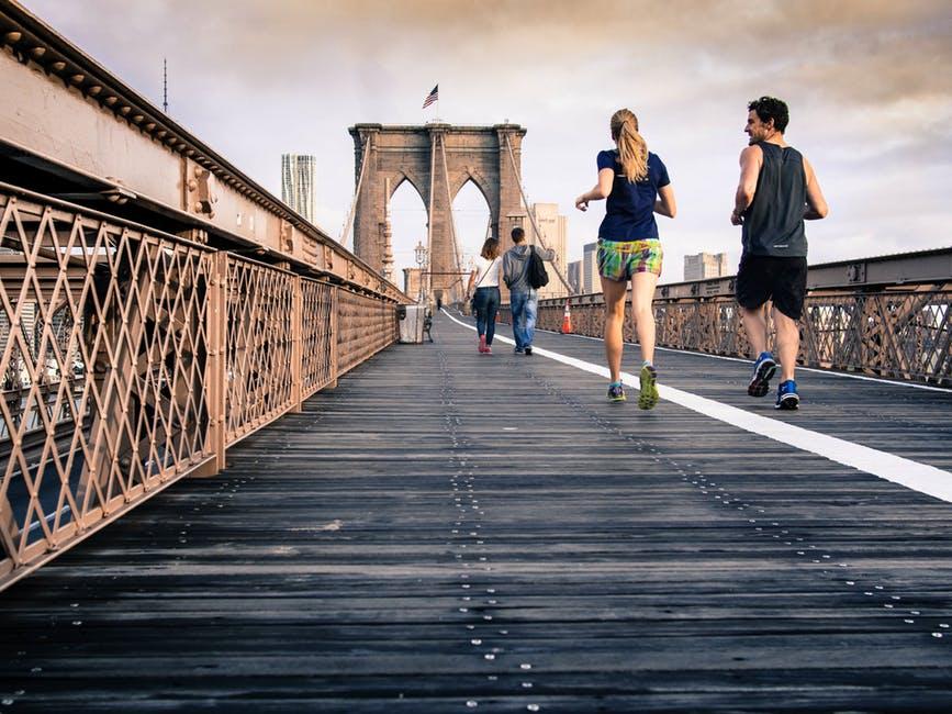 Fitness Expert jogging on bridge together