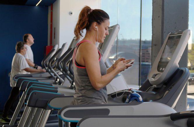 woman on treadmill gym essentials