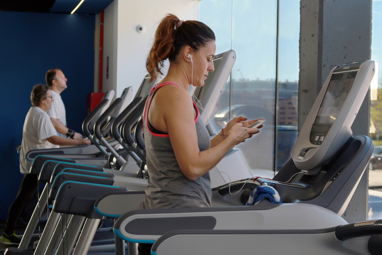 woman on treadmill gym essentials