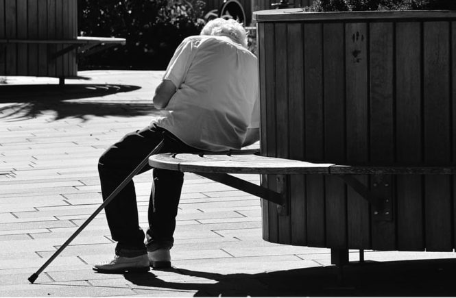 Seniors health issues man on bench