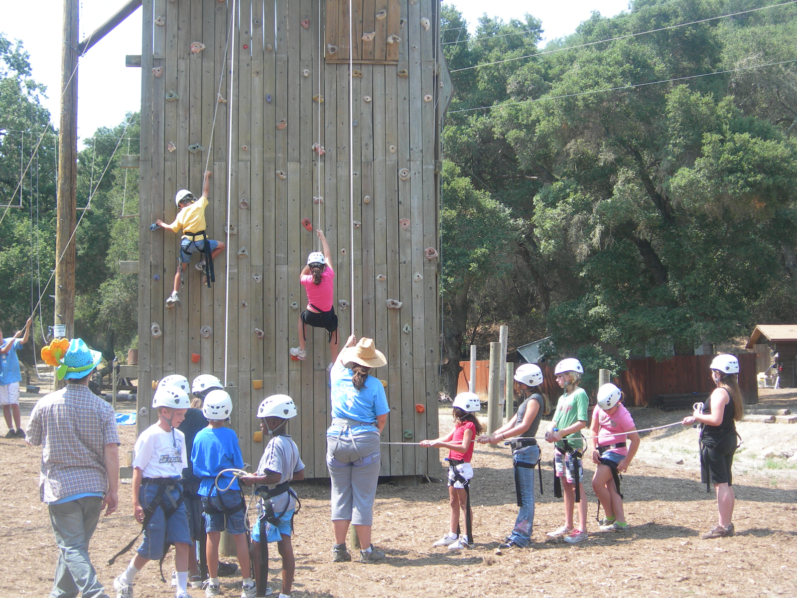 Fitness climbing rock wall with people