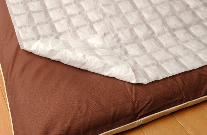 waterproof mattress pad on top of mattress