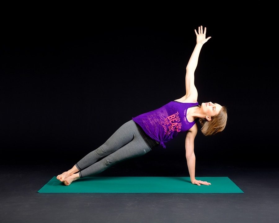woman yoga stretching at sky