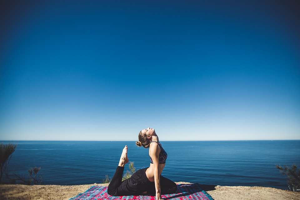 woman yoga and stretching to the sky