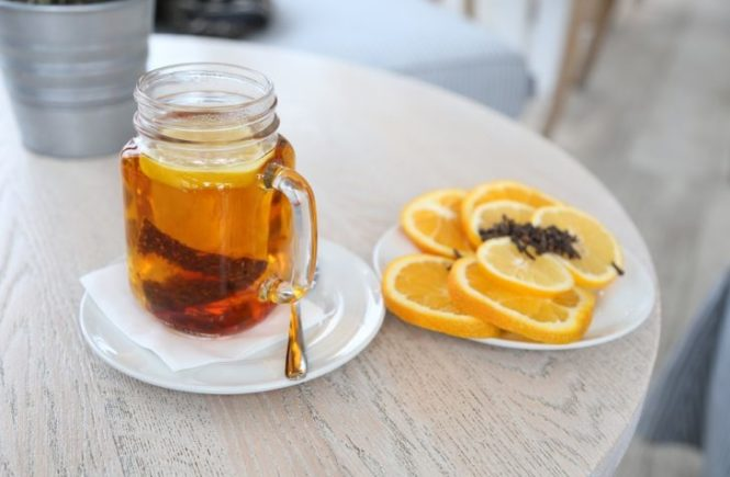 Kombucha Tea with lemons on table