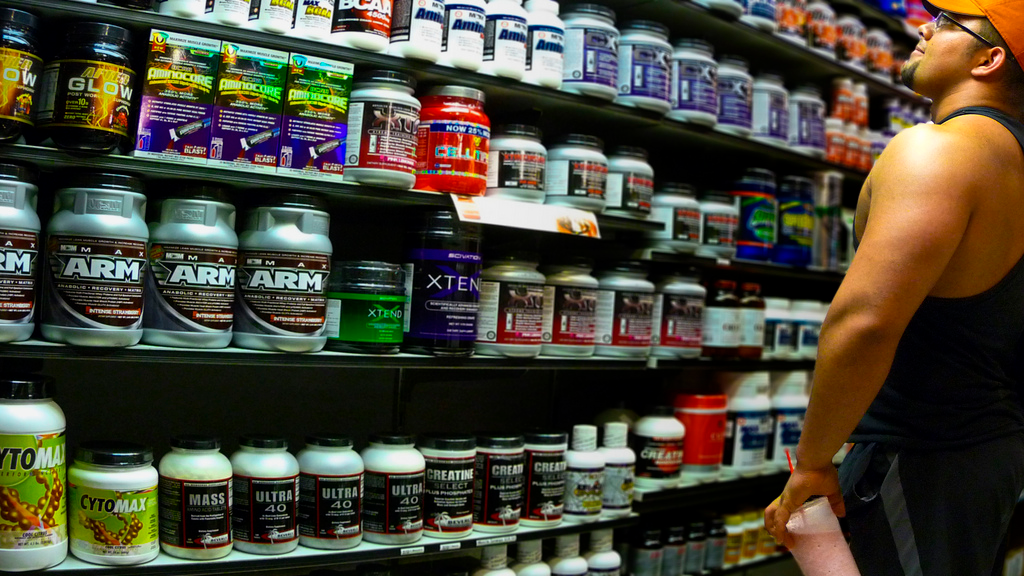 lose weight supplement rack in store with man
