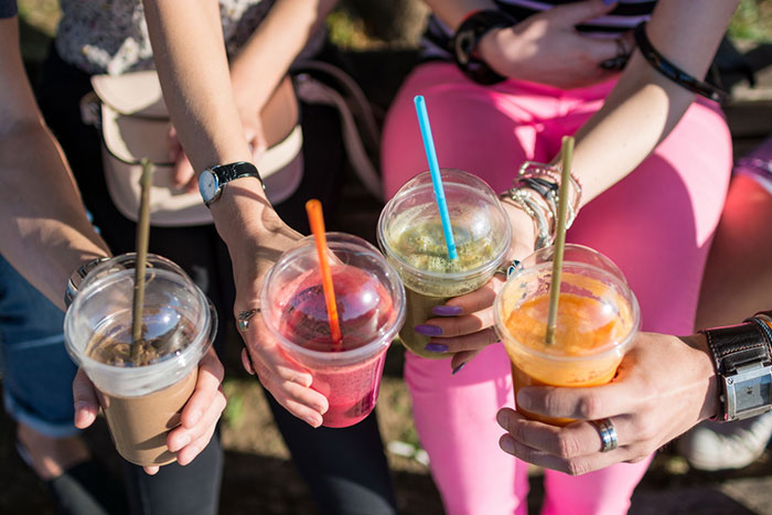 friends cheering with smoothies