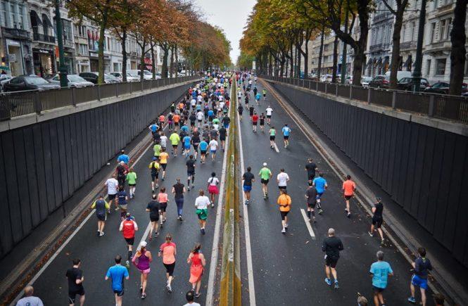 people running marathon race in a crowd