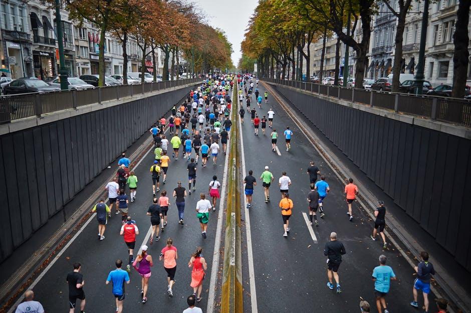 running marathon race crowd of runners