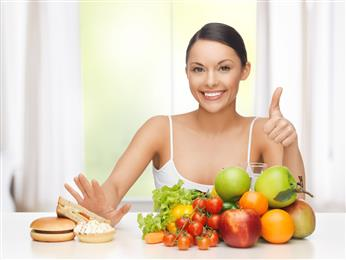 woman thumbs up to fruit