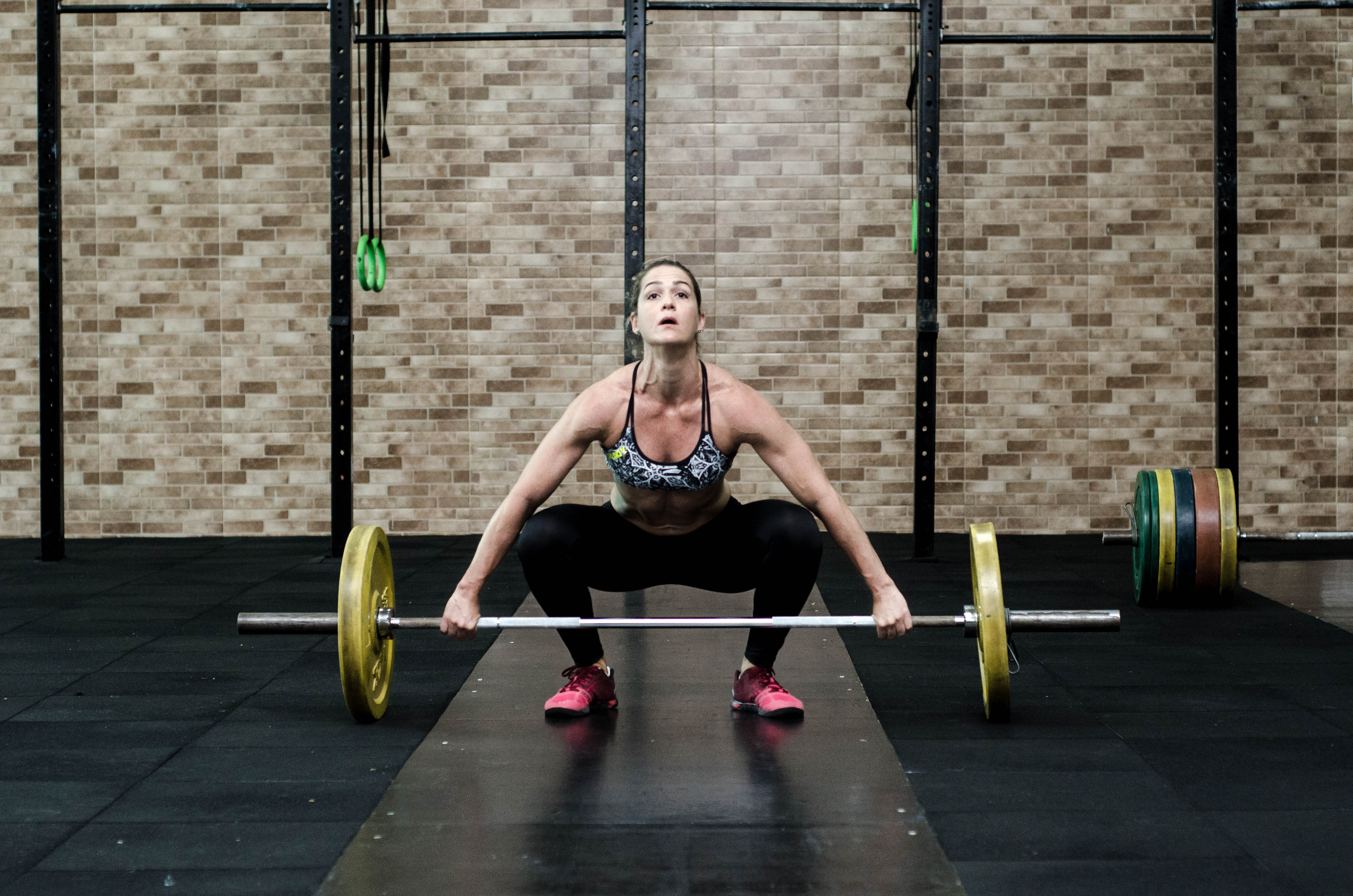 exercising woman with barbell