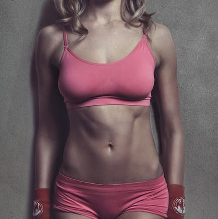 woman pink outfit summer abs