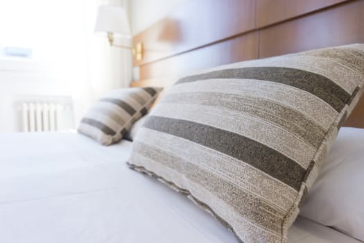 Enhance Your Energy pillows on bed