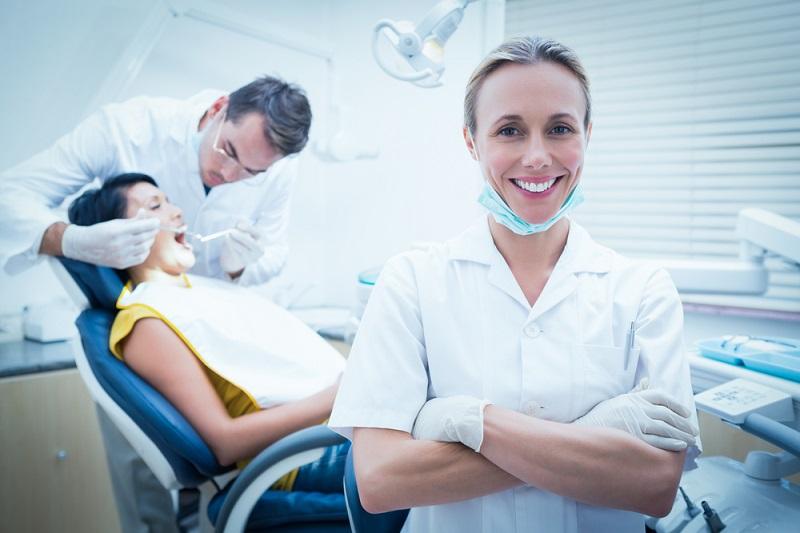 Dental Implants happy hygienist smiling