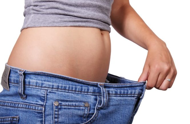 Body Fat measuring waist in jeans