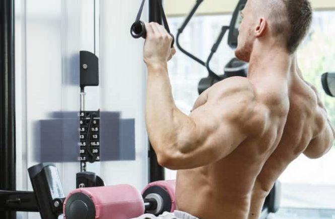 Anavar-10 man lat pulldowns in gym