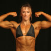 Muscle Growth woman bodybuilder flexing