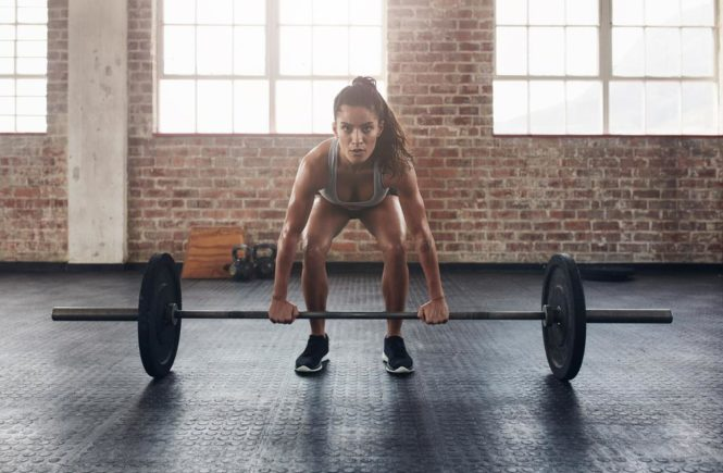 Bodybuilding woman with barbell