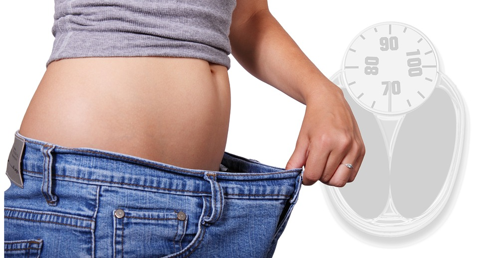 Weight Loss checking waist band of jeans