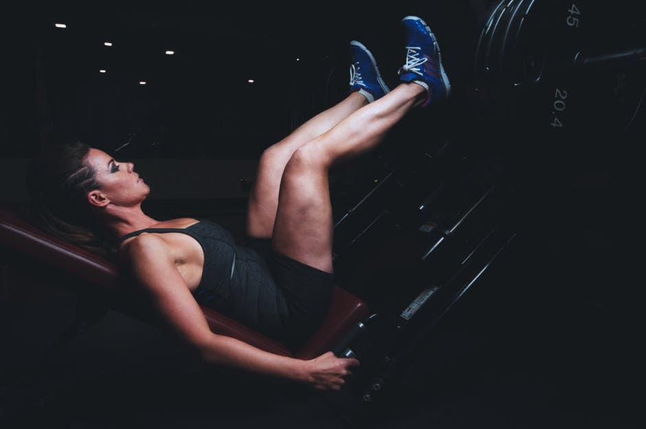 Fitness Motivation woman leg pressing