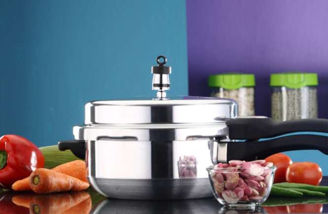 pressure cooker steaming on counter