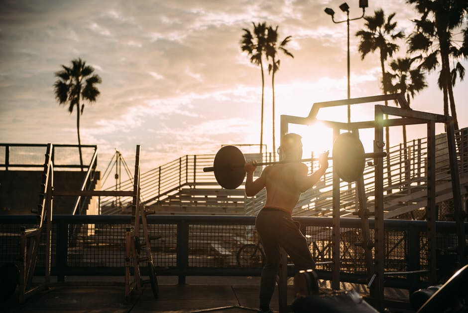 Fitness squats outside at muscle beach