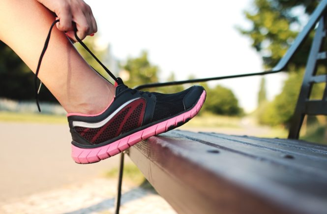 fitness lacing up running shoes