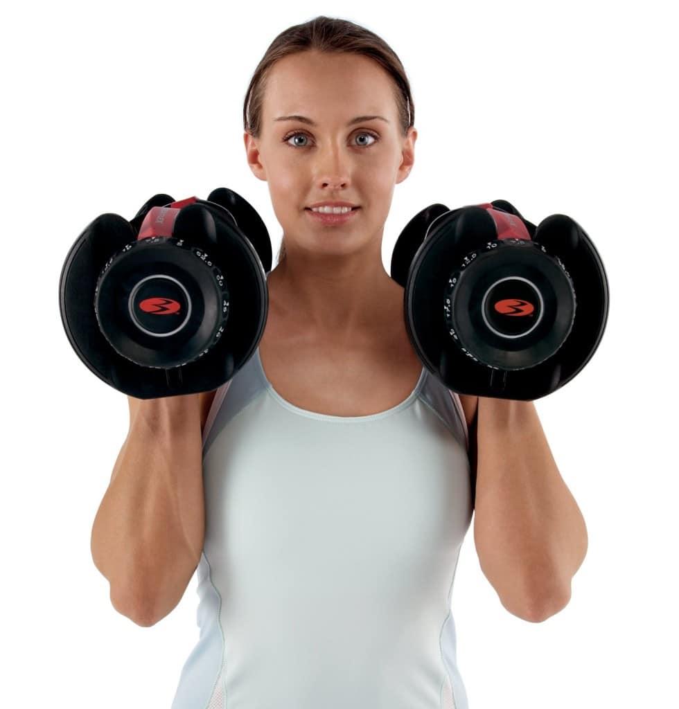 dumbbells woman holding bowflex selectech