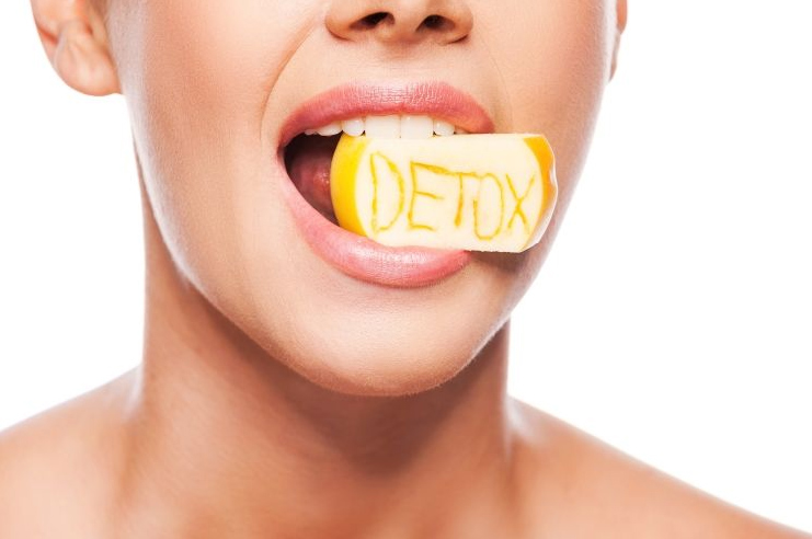 Detox Drinks woman lemon in mouth