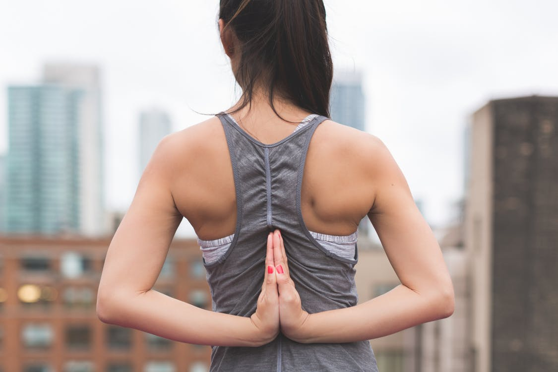 Health woman with hands behind her back