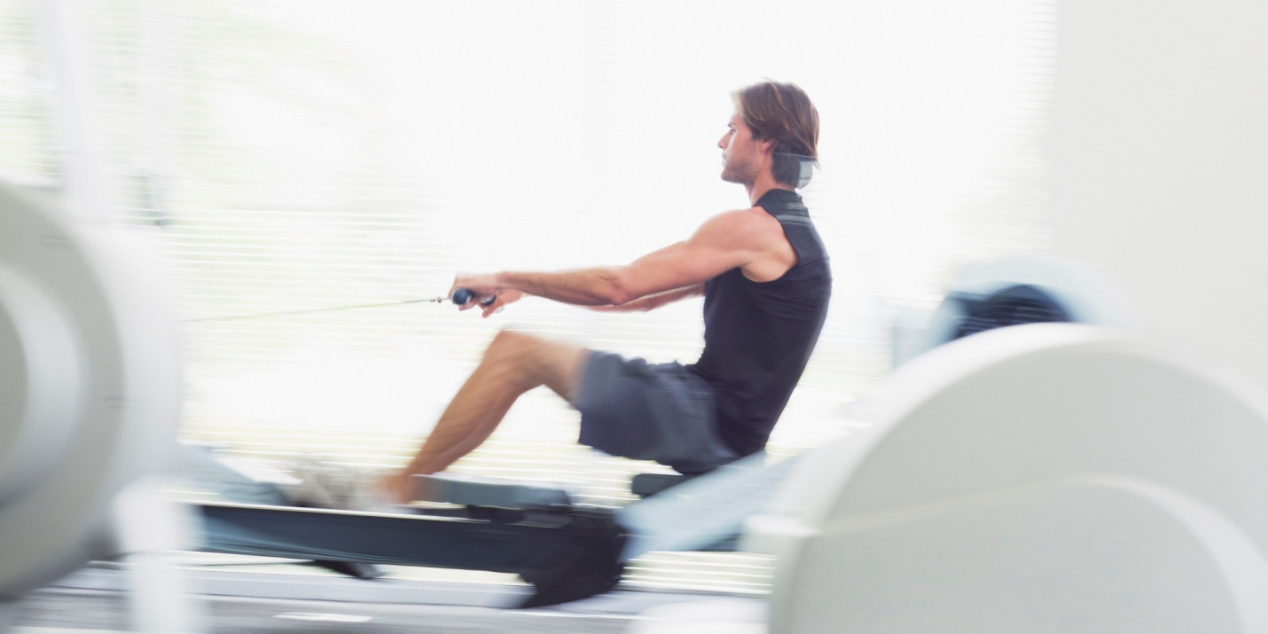 Rowing Machine man intense workout