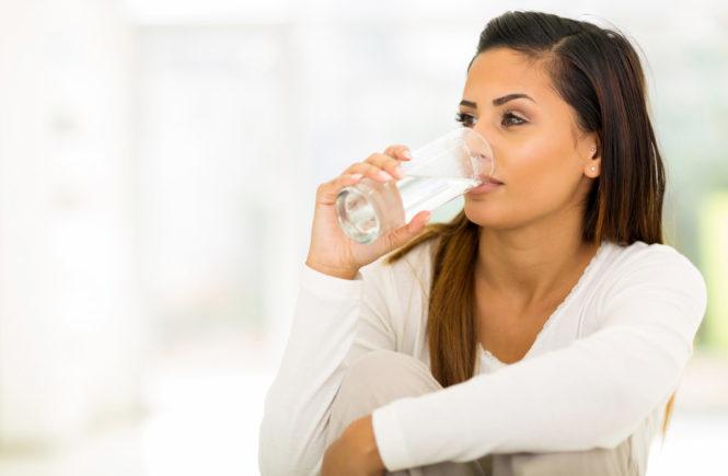 Eczema skin drinking glass of water